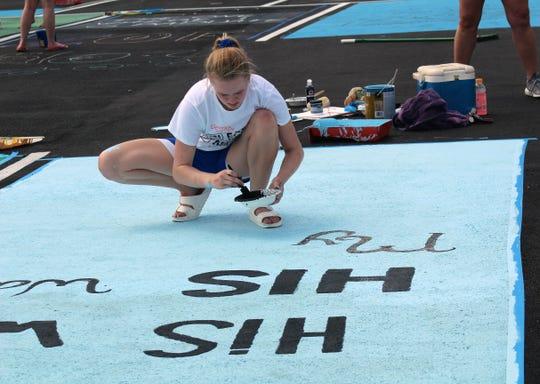 Fairfield High School senior Rylee Feldmann used a biblical reference when she painted her parking spot.