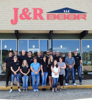 Employees of J&R Door at the new location on U.S. 36. The business has 19 employees and the move has allowed them to add new products, such as windows and manufactured stone for homes.
