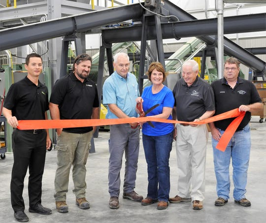 A ribbon-cutting ceremony was held recently for the new Coshocton Soy Processing ExPress Meal and Oil facility part of Coshocton Grain Company. Participating were Jason Buseman of Insta-Pro International, Jamie McCahill of Schilling Electric, plant operations manager Ron Warnock, Coshocton Grain CEO Rhoda Crown, board chairman Larry Endsley and Dennis Wagenblast of Custom Agri Systems.