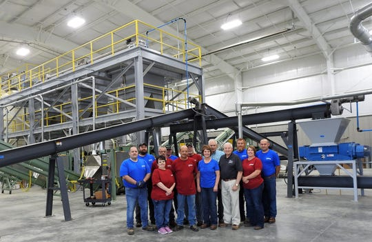Employees of Coshocton Grain and Coshocton Soy Processing ExPress Meal and Oil inside the recently-opened facility poised to process 3.36 million bushels of soybeans annually from farmers in Coshocton and the surrounding seven counties.