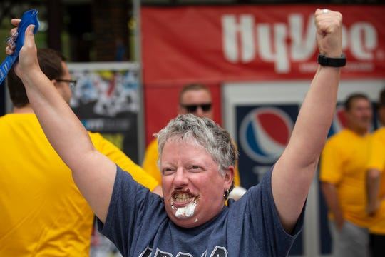 Angela Stickels of Afton reacts after winning the pie eating contest during the Iowa State Fair on Thursday, Aug. 15, 2019 in Des Moines.