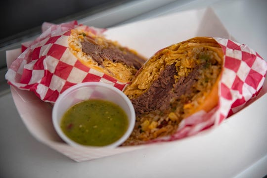 G Mig's Wrap Stand won the People's Choice Best New Food with 'Georgie's Roast with the Most Wrap'. The jalapeno-cheddar tortilla contains cheddar jack cheese, rice with chilies and chorizo, slow-roasted pot roast, candy corn salsa, crushed tortilla chips, and sour cream—served with salsa verde.