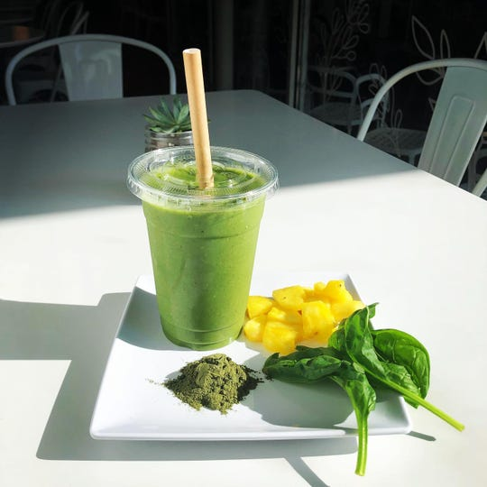 A Green Goodness smoothie from Nosh Cafe & Eatery made with spinach, banana, pineapple, kiwi, almond mild, wheatgrass and agave.