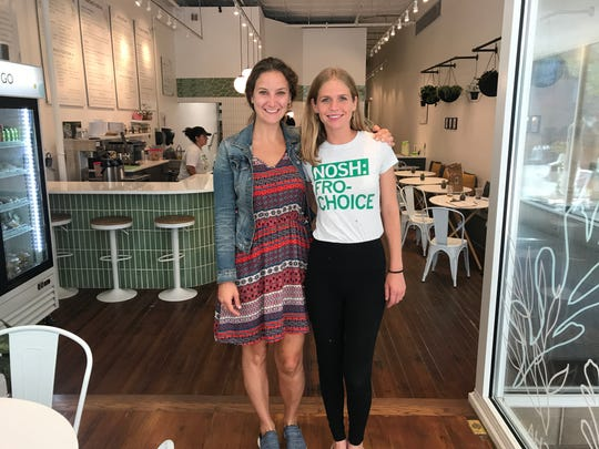Veronica Tessler, 34, and Lesley Rish, 31, stand inside their new restaurant and frozen yogurt shop, Nosh Cafe & Eatery in East Village.