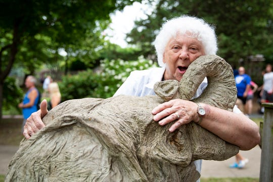 """Rose Bowery was four years old when she donated ten cents to the Iowa State Fair's Baby Mine. Today, at 94, she returned to see the elephants statue during the fair on Thursday, Aug. 15, 2019 in Des Moines. """"This was the first thing I wanted to come see,"""" Bowery said with a smile."""
