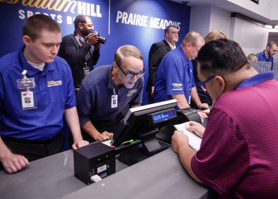 Sports Betting officials take bets at the William Hill Sports Book at Prairie Meadows Casino in Altoona, on Thursday, August 15, 2019. Thursday was the first day for legalized sports betting in the state of Iowa.