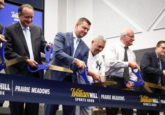 State senator Jack Whitver helps cut the ribbon at the new William Hill Sports Book at Prairie Meadows Casino in Altoona, Iowa, on Thursday, August 15, 2019. Thursday was the first day for legalized sports betting in the state of Iowa.
