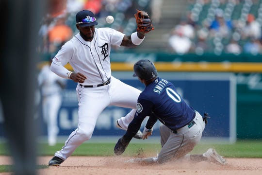 Tigers shortstop Niko Goodrum is unable to make an out at second base against Mariners right fielder Mallex Smith during the seventh inning of the Tigers' 7-2 loss on Thursday, Aug. 15, 2019.