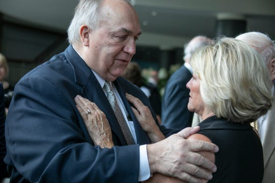 Former Michigan Gov. John Engler, left, shares a moment with Kathy Patterson, ex-wife of L. Brooks Patterson as family, friends, colleagues and constituents gather at Woodside Bible Church in Troy Thursday, Aug. 15, 2019 to celebrate the life of L. Brooks Patterson, the lively and sometimes controversial Oakland County Executive since 1992. Patterson died Aug. 3, 2019.