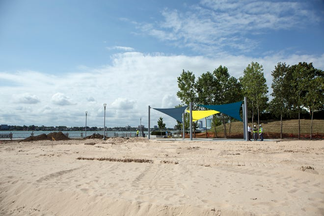 The soon-to-open beach between Chene and Joseph Campau on the east Riverfront has a large sandy beach, playscape and events shed as part of the amenities on the RiverWalk. It also has a new name.