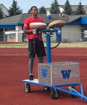 Walled Lake Western wide receiver Abdur-Rahmaan Yaseen operates the jugs machine during practice.