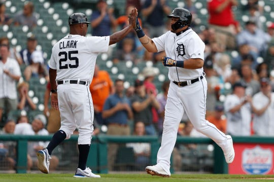 Tigers designated hitter Miguel Cabrera celebrates with third base coach Dave Clark after hitting a solo home run during the fourth inning on Thursday, Aug. 15, 2019, at Comerica Park.