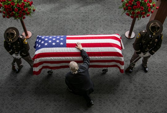 """""""He was my mentor and friend,"""" said David Nagy, who kneeled to pay his respects at funeral services for longtime Oakland County Executive L. Brooks Patterson at Woodside Bible Church in Troy Thursday."""