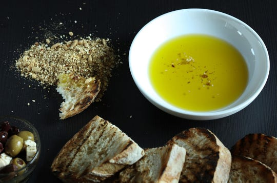 Dukkah is a simple dish whose beguiling aroma and complex flavor reward beyond all expectations. Serve it with torn pieces of good bread, dipping in oil then in the spice and nut blend.
