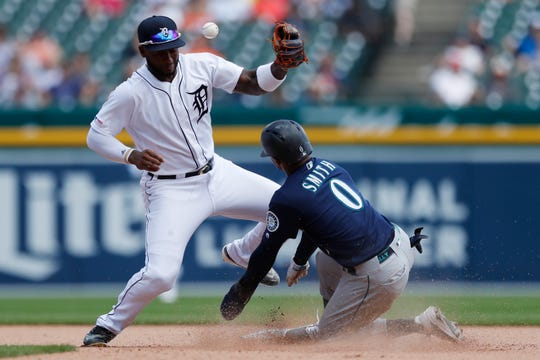 Detroit Tigers shortstop Niko Goodrum misplays the throw from catcher John Hicks to allow the Seattle Mariners' Mallex Smith to safely steal second base during the seventh inning.