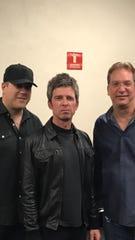 Trombonist John Rutherford, singer Noel Gallagher, saxophonist Keith Kaminski