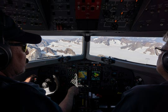 Pilots Andy Ferguson, left, and Don Watrous, fly a plane carrying NASA scientists on a mission to track melting ice in eastern Greenland.