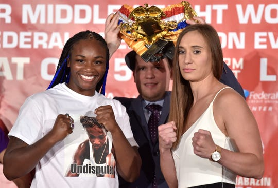 Claressa Shields poses for photographers with her opponent, Ivana Habazin, and promoter Dmitriy Salita, CEO of Salita Promotions, on Wednesday in Detroit.