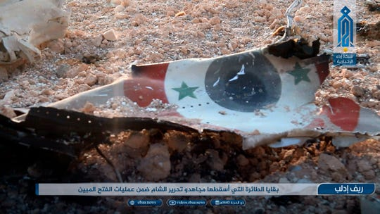 """This photo provided by the Ibaa News Agency, the media arm of al-Qaida's branch in Syria, purports to show part of a Syrian warplane that was shot down by rebel fighters over Idlib province in Syria, Wednesday, Aug 14, 2019. The Britain-based Syrian Observatory for Human Rights, a war monitor, said the warplane was shot down on the southern edge of Idlib province, while activist Taher al-Omar who has close links with militants said it was a Russian-made SU-22. The caption in Arabic reads:  """"The remains of the warplane that was shot down by holy warriors of Hayat Tahrir al-Sham as part of the Great Conquest operations."""""""