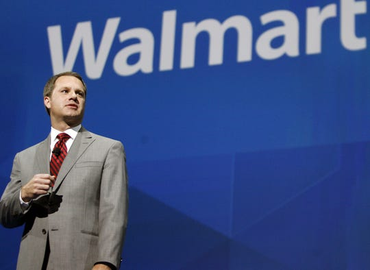 In this June 7, 2013 file photo, Doug McMillon, President and CEO, Wal-Mart International, speaks at the shareholders meeting in Fayetteville, Ark. McMillon has called for an assault weapons ban to be debated by Congress and said he's encouraged by growing support for gun-control measures like background checks.