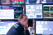 In this Aug. 14, 2019, file photo specialist Glenn Carrel works at his post on the floor of the New York Stock Exchange. A sharp dip in bond yields shine a brighter spotlight on some of the S&P 500's best dividend deals as investors face an increasingly volatile market amid trade wars and economic growth concerns.