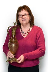 Marilyn Beckham of Bloomfield Hills shows off a decorative piece called a ewer.