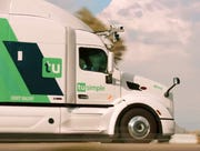 United Parcel Service Inc. is taking a minority stake in self-driving truck company TuSimple and conducting test runs with the startup.