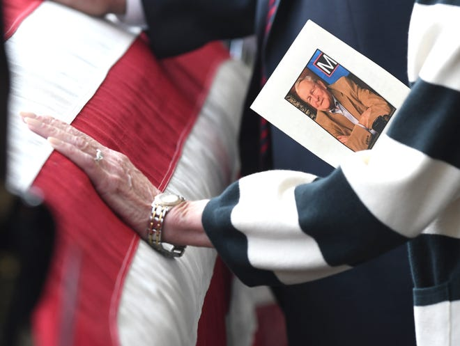A mourner pays her respects during the public visitation for the late Oakland County Executive L. Brooks Patterson.
