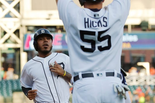 Detroit Tigers' John Hicks (55) waits on teammate Harold Castro as they both score on a single by Victor Reyes during the second inning.