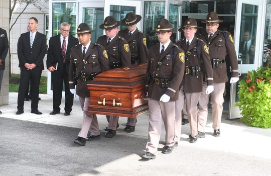 The Oakland County Sheriff's Office Honor Guard carries the casket of Oakland County Executive L. Brooks Patterson after his funeral at Woodside Bible Church in Troy.