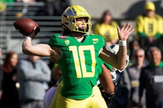 Oregon quarterback Justin Herbert, who threw for over 3,000 yards last season, will have the same coach in consecutive years.