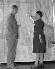 Loja Saarinen shows husband Eliel, the architect who built Cranbrook, a cartoon of her tapestry Sermon on the Mount, in 1941.