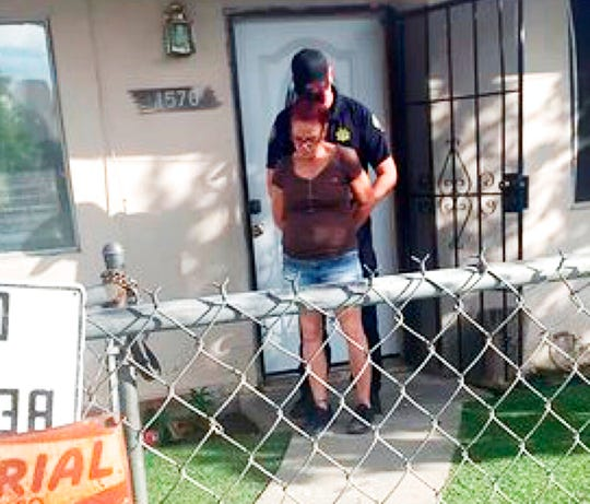 This April 22, 2019, file photo taken by a Riverside County Animal Services officer shows the arrest of Deborah Sue Culwell at her Coachella, Calif., home. Culwell who authorities caught on surveillance video in April dumping a bag of 3-day-old puppies into a trash can has received jail time after changing her plea to guilty.