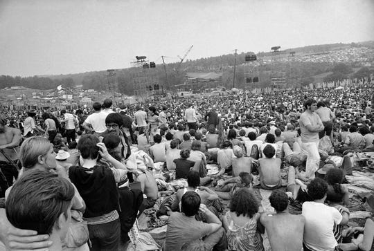 This Aug. 14, 1969 file photo shows a portion of the 400,000 concert goers who attended the Woodstock Music and Arts Festival held on a 600-acre pasture near Bethel, N.Y. For the first time, an audio recording is available of nearly everything heard onstage at Woodstock 50 years ago - from transcendent music to announcements about lost people and bad acid.