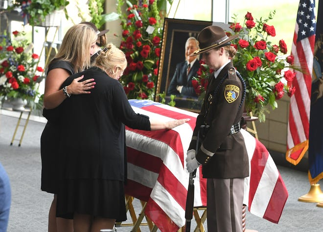 Jennifer Llewellyn, left, comforts fellow Oakland County employee Jamie Fenner during the visitation for the late Oakland County Executive L. Brooks Patterson at Woodside Bible Church in Troy on Thursday, August 15, 2019.