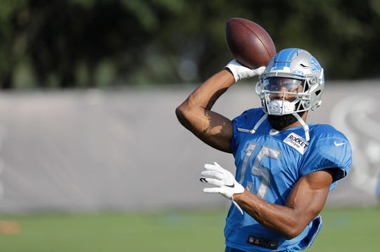 Detroit Lions wide receiver Chris Lacy throws a pass during a joint practice with the Houston Texans on Thursday.