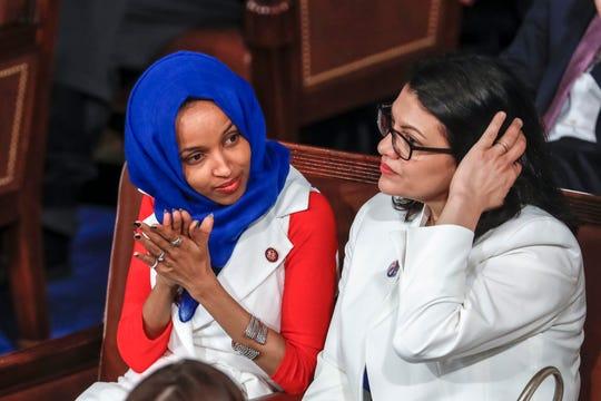 Rep. Ilhan Omar, D-Minn., left, and Rep. Rashida Tlaib, D-Detroit, at President Donald Trump's State of the Union speech.