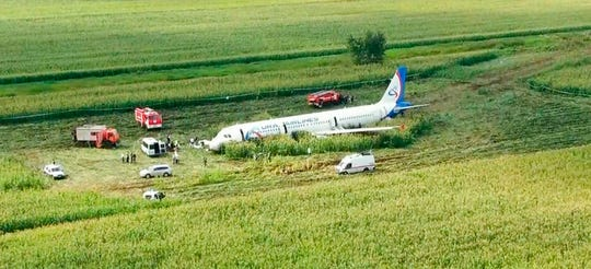 In this video grab provided by the RU-RTR Russian television, a Russian Ural Airlines' A321 plane is seen after an emergency landing in a cornfield near Ramenskoye, outside Moscow, Russia, Thursday, Aug. 15, 2019.