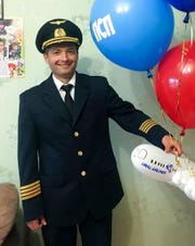 In this handout photo taken in 2018 and released by e1.ru , Damir Yusupov, 41, the captain of Ural Airlines A321pose for a photo in Yekaterinburg, Russia. The captain of a Russian passenger jet was hailed as a hero Thursday for landing his plane in a cornfield after it collided with a flock of gulls seconds after takeoff, causing both engines to malfunction. While dozens of people sought medical assistance, only one was hospitalized.