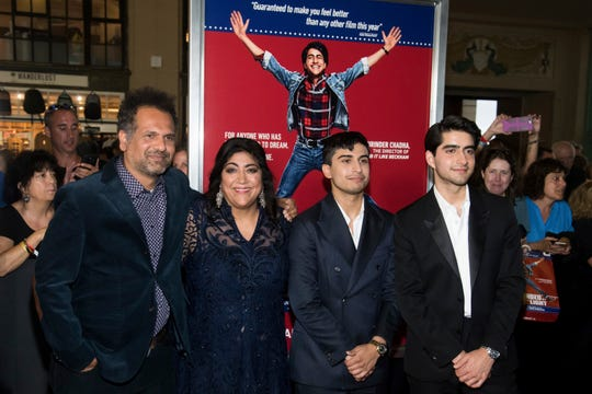 "Sarfraz Manzoor, left, Gurinder Chadha, Aaron Phagura and Viveik Kaira attend the premiere of ""Blinded by the Light"" at the Paramount Theater on Aug. 7, 2019, in Asbury Park, New Jersey."