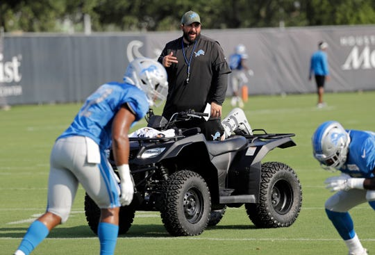 Detroit Lions coach Matt Patricia instructs players during a joint NFL training camp football practice with the Houston Texans.