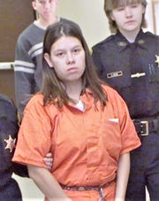 Murder suspect Elizabeth Kettle is led into the Schuyler County Courthouse in 2004 for a court proceeding in her case.