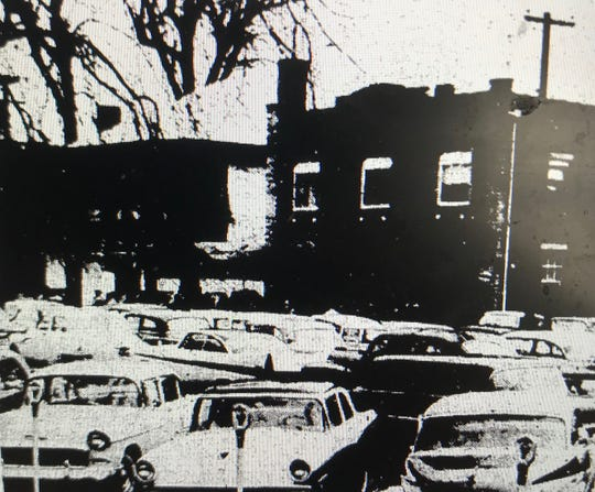 Scores of cars cluster outside Curley Shelton's funeral on Dec. 8, 1957.