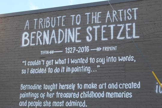 A new downtown mural by Bradley Scherzer pays tribute to local artist Bernadine Stetzel. The mural was painted on the side of the Brady Mercantile Building on Front Street in Fremont.