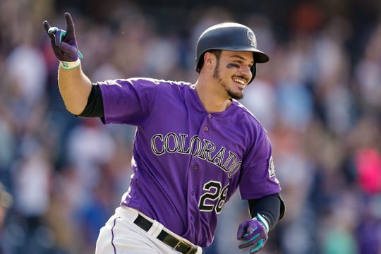 Colorado Rockies third baseman Nolan Arenado celebrates after hitting a walk-off home run in the ninth inning Wednesday night in a win over the Arizona Diamondbacks. The Rockies open a three-game home series against the Miami Marlins at 6:40 p.m. Friday at Coors Field in Denver.