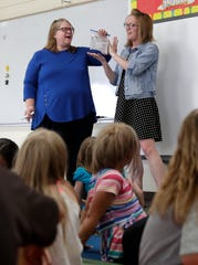 Betty Jo Derozier and Jacki Seeber, kindergarten teachers at Wabeno Elementary School, lead a science experiment on June 4, 2019 in Wabeno, Wis. Sarah Kloepping/USA TODAY NETWORK-Wisconsin