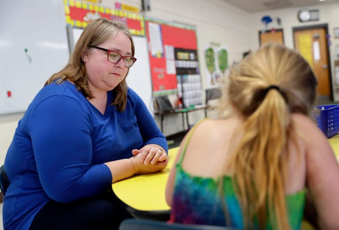 Betty Jo Derozier, kindergarten teacher at Wabeno Elementary School, helps a student with a math problem on June 4, 2019 in Wabeno, Wis. Sarah Kloepping/USA TODAY NETWORK-Wisconsin