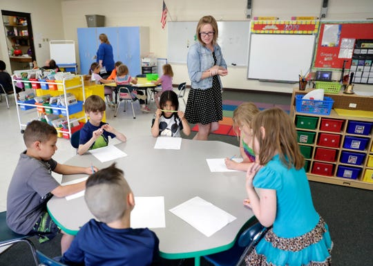 Jacki Seeber, kindergarten teacher at Wabeno Elementary School, works with students in her classroom on June 4, 2019, in Wabeno, Wis. Sarah Kloepping/USA TODAY NETWORK-Wisconsin