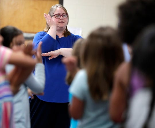 Betty Jo Derozier, kindergarten teacher at Wabeno Elementary School, follows a dance routine with students before starting a science lesson on June 4, 2019, in Wabeno, Wis.