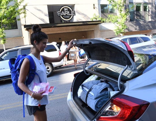 Madison Albin, a senior at Clemson University, lived in apartments at 114 Earle for two years. She was expecting to live there for a third year, but was told in an email that she would have to find alternative housing. She's seen here packing things into a friend's car on Aug. 15, 2019.